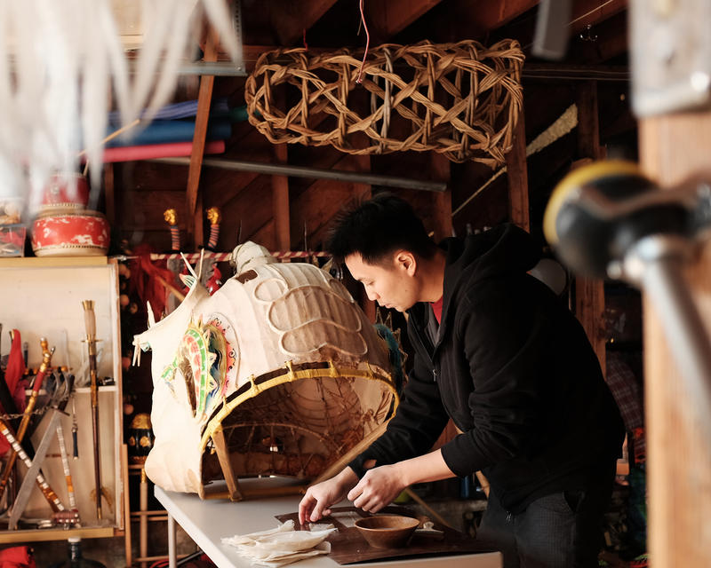 Travis Lum repairs a lion head for Chinese New Year celebrations.