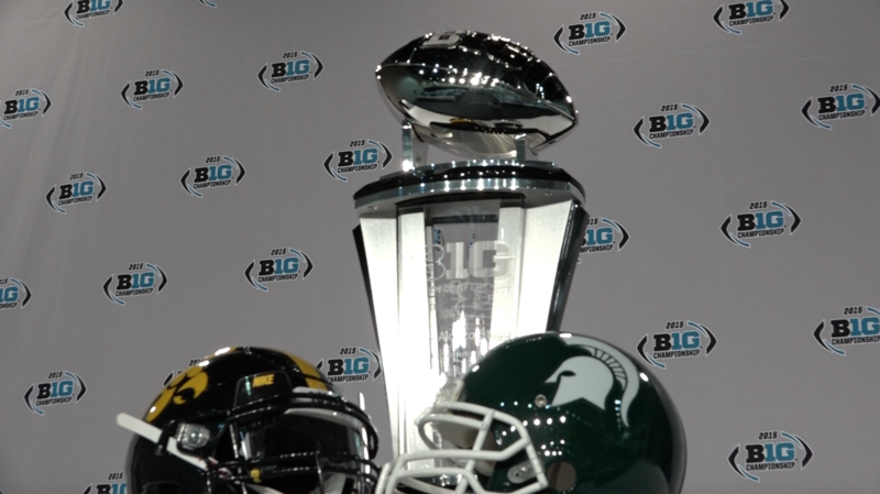 The Big Ten Championship trophy on display at Lucas Oil Stadium on the eve of kickoff.