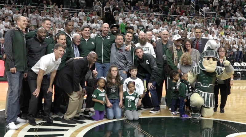 The 2000 MSU national championship men's basketball team poses for a picture at halftime of the Spartans victory over the Florida Gators on Saturday night.