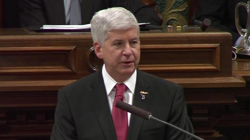 Governor speaking at podium