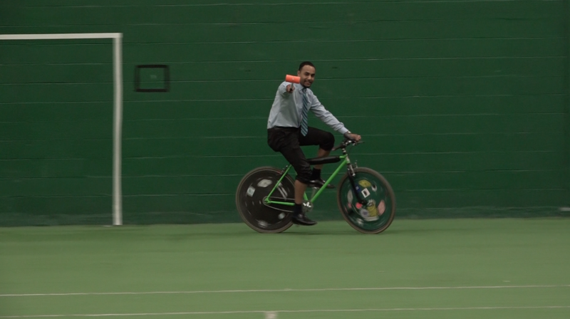 WKAR's Al Martin gives bike polo a shot at IM West on the campus of Michigan State University.
