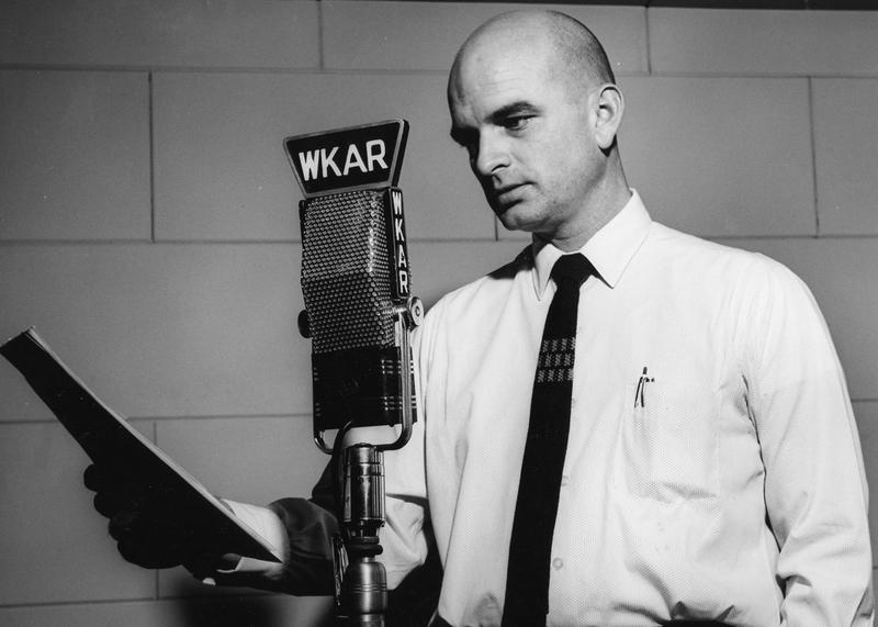 Dick Estell reading at WKAR microphone