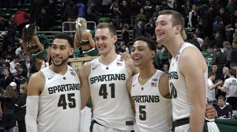 (From left to right.) MSU seniors Denzel Valentine, Colby Wollenman, Bryn Forbes and Matt Costello celebrating Senior Day.