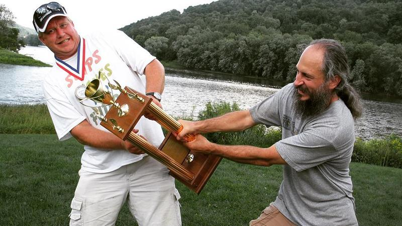 Two men fighting over trophy