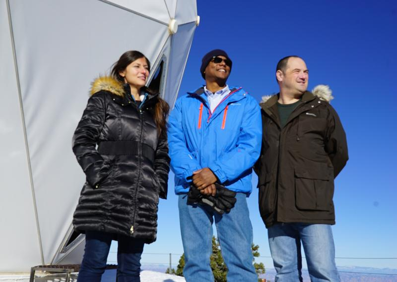 Marisol, Norman and Paul on top of Mount Lemmon observatory. This is as part of the final Demo where they have used atomic clocks to see the affects of gravity on time.