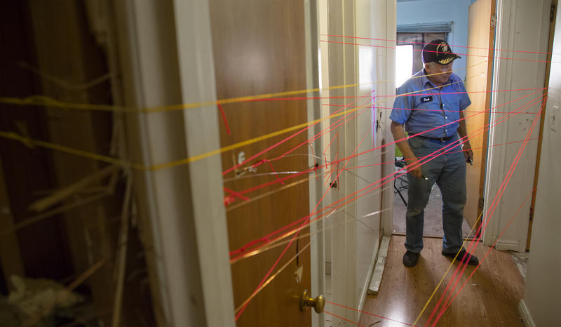 Dub Lawrence investigates shooting at Matthew Stewart's home. The red strings represent bullets fired by police, the yellow represent bullets fired by Matthew Stewart.