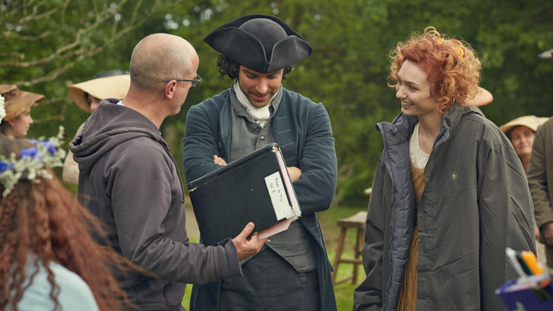 Aidan Turner as Ross Poldark and Eleanor Tomlinson as Damelza on set with the director.