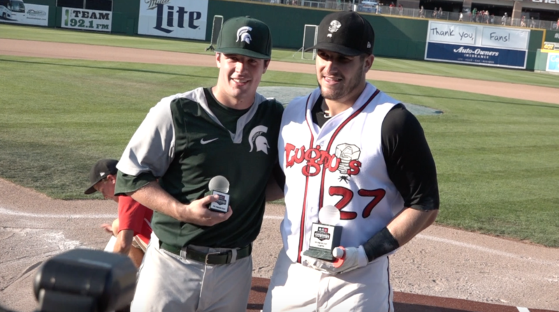 "Lansing Lugnuts left fielder Connor Panas holds the 1st place trophy next to 2nd place MSU Junior infielder Dan Durkin after the Home Run Derby prior to this year's ""Crosstown Showdown."""