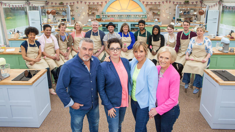 The judges, hosts, and contestants of The Great British Baking Show, Season 3. Contestants (back, l-r): Dorret, Alvin, Ian, Ugne, Paul, Stu, Marie, Tamal, Nadiya, Flora, Mat, Sandy. Judges/Hosts (front, l-r): Paul Hollywood, Sue Perkins, Mel Giedroyc, Mar