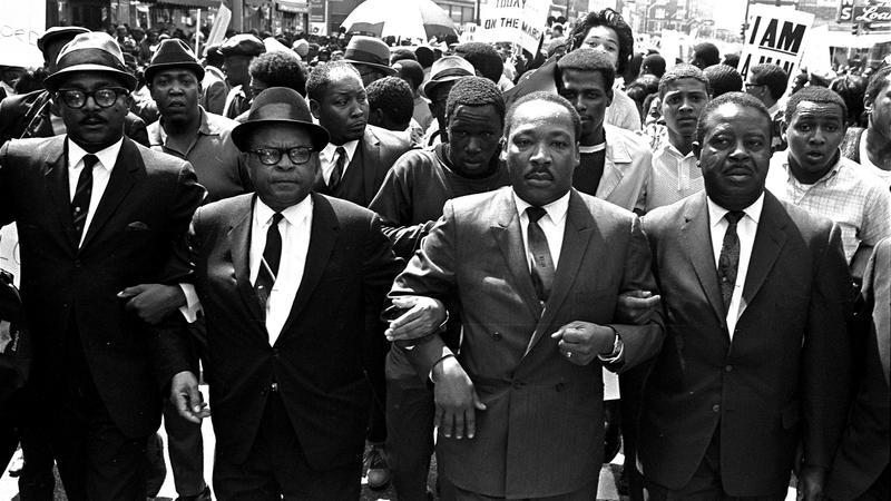 The Rev. Ralph Abernathy, right, and Bishop Julian Smith, left, flank Dr. Martin Luther King, Jr., during a civil rights march in Memphis, Tenn., March 28, 1968.