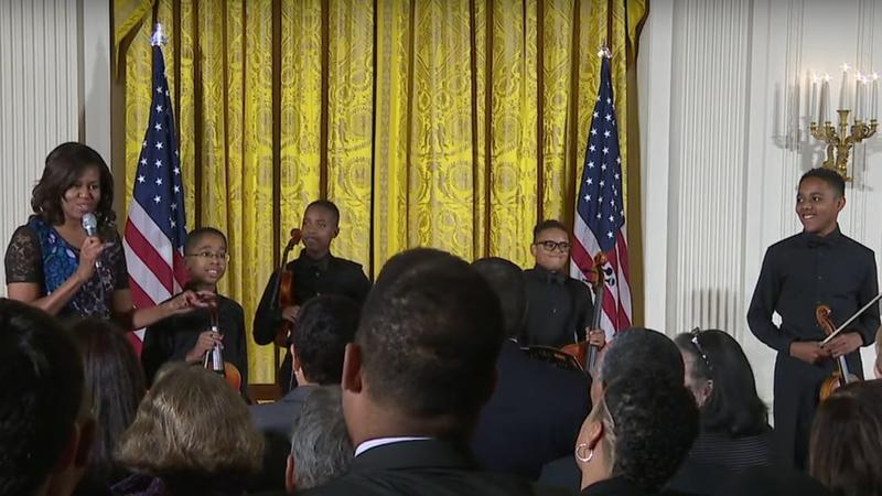 Michelle Obama with Perfect Fourth String Quartet photo