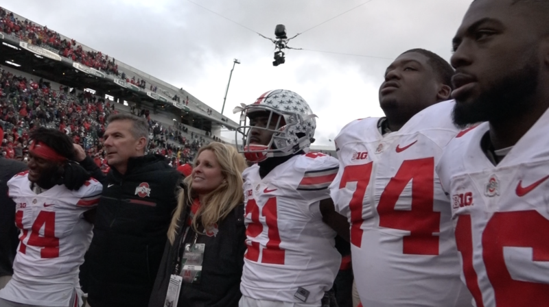 Ohio State football coach Urban Meyer joins his team in singing the fight song after beating Michigan State by one point on Saturday afternoon.