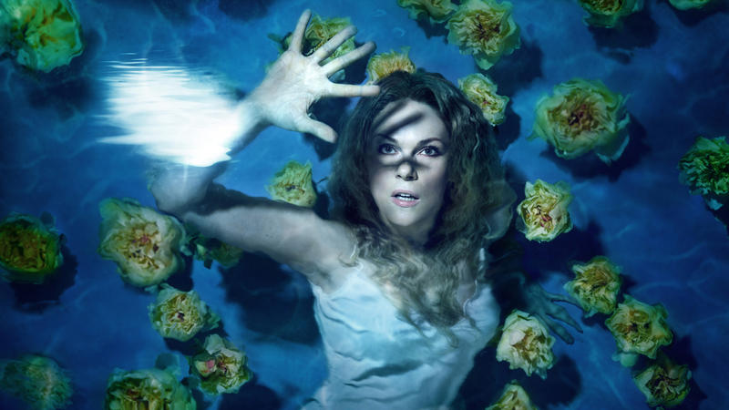 Kristine Opolais underwater playing the role of Mary Zimmerman