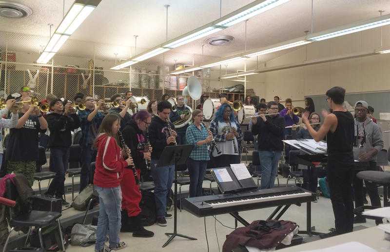 Members of the Everett band warming up in their band room
