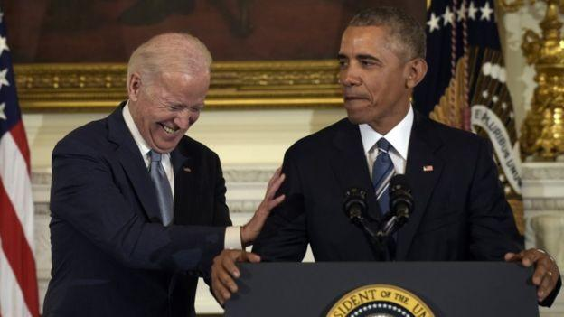 Vice President Biden shares a laugh with President Obama before being award the US Medal of Freedom