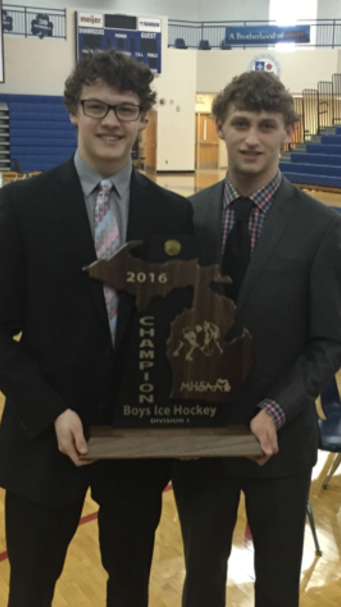 Sheldon (left) and Mitchel (right) with the state championship trophy.