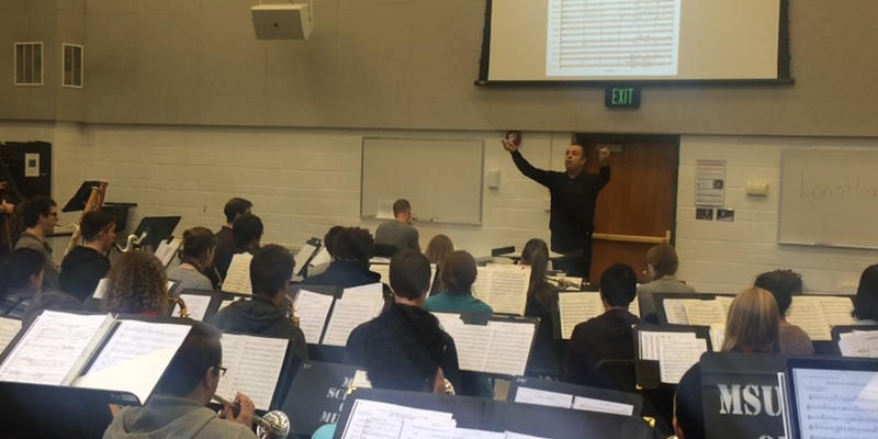 Kevin Sedatole leading the MSU Wind Symphony in rehearsal of Copland's 'Lincoln Portrait'