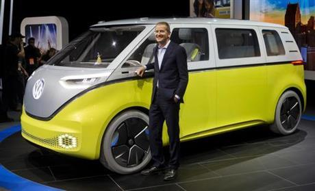 Herbert Diess, chairman of the Volkswagen brand, poses with VW I.D. Buzz concept car