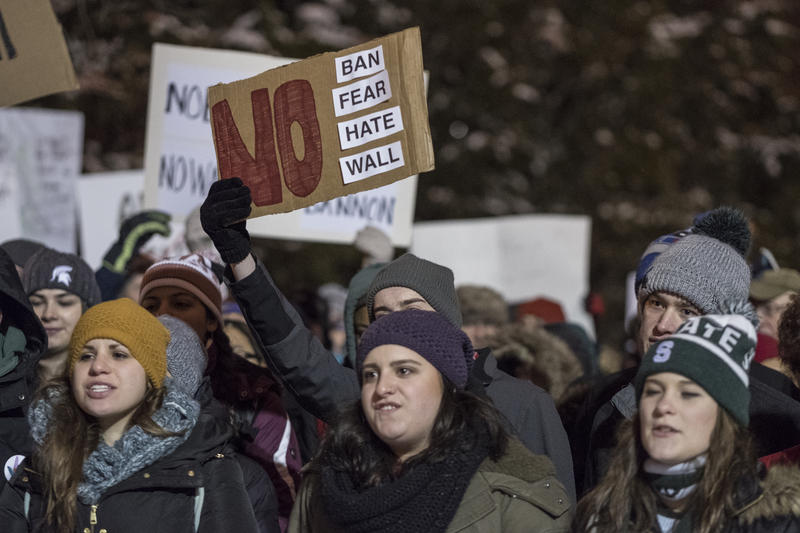 Tuesday night's rally at The Rock drew hundreds in opposition to President Trump's recent executive actions
