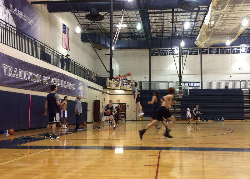ELHS players and Brandon Johns dunking at practice.