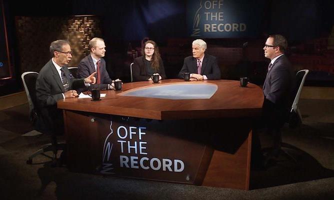 Journalists interviewing St. Rep Jim Tedder
