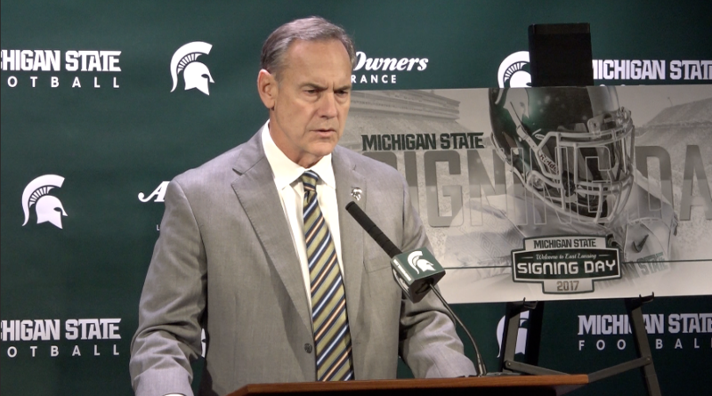 Michigan State head football coach Mark Dantonio at a podium