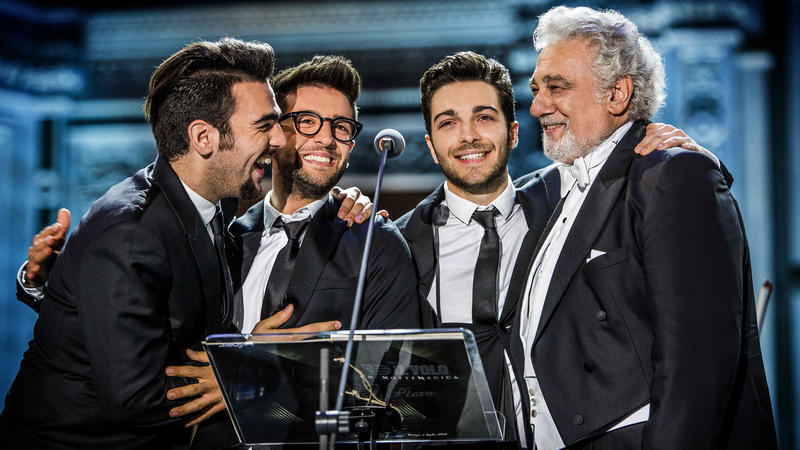 Il Volo and Plácido Domingo at a podium