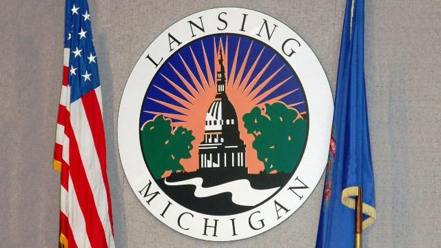 City of Lansing seal and flags displayed