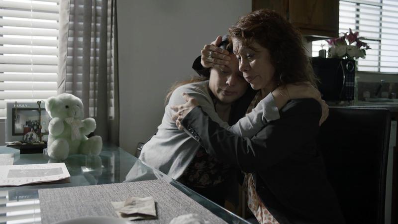 Leticia Moreno Gomez comforts her daughter Marissa Ramirez.