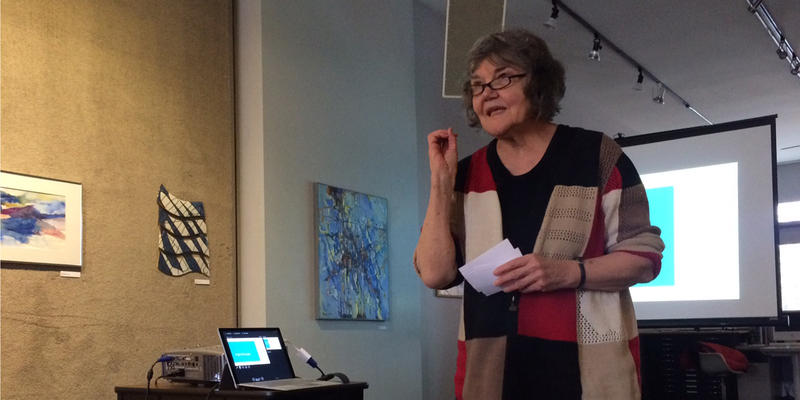 Ruelaine Stokes speaking at the MICA Gallery about the forthcoming Lansing Poet Laureate position.