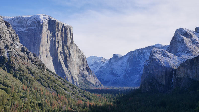 The first snow of winter coats El Capitan and the surrounding mountains. It was the power of water that carved out Yosemite Valley, and 2,000-foot glaciers polished the granite into their iconic shapes. Yosemite National Park, California.