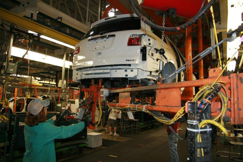 workers making a GMC Acadia