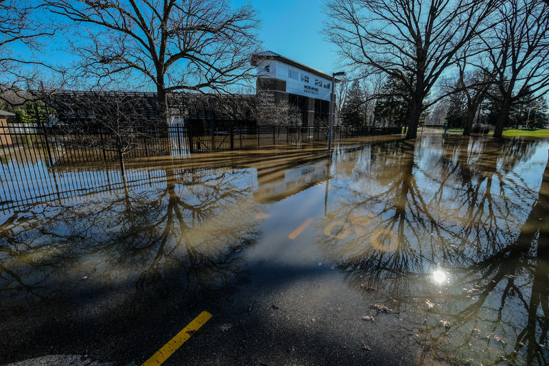 Bicycle and pedestrian pathways remain closed between Jenison Fieldhouse and Old College Field as flood waters from the Red Cedar river reach 8.4 feet on April 8, 2017. Flood stage is 7.0 feet.
