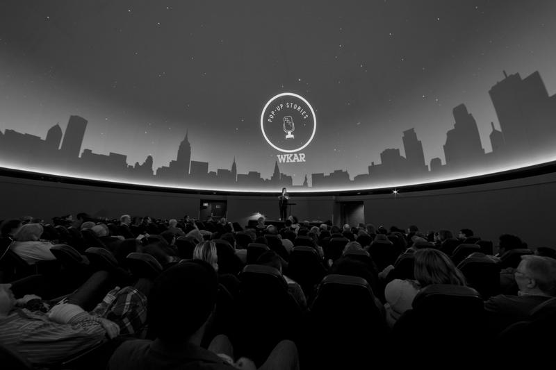 The audience sits in Abrams Planetarium underneath the starry ceiling.