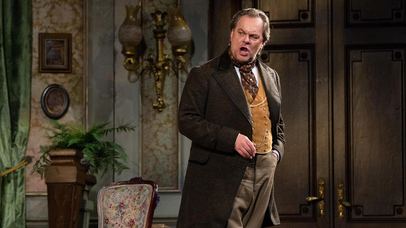 Met Opera: Michael Volle in brown suit