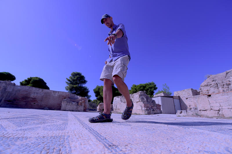 MSU archaeologist Jon Frey studies an ancient mosaic