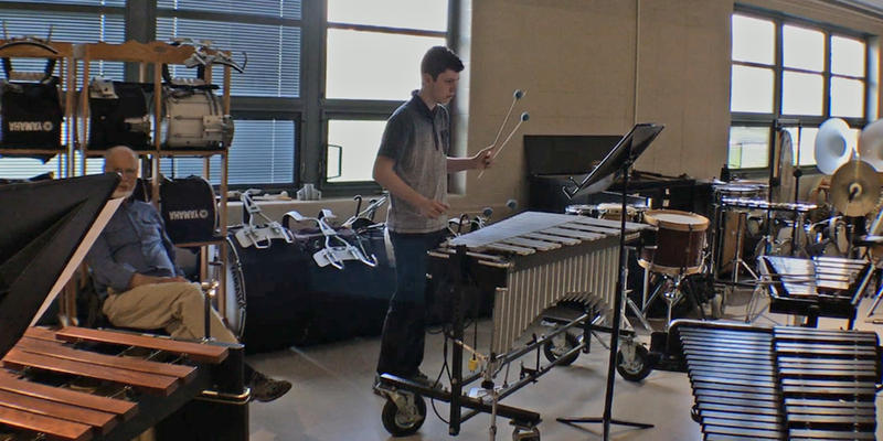 Composer and Percussionist Ancel Neeley rehearsing his piece with the Meridian Community Band