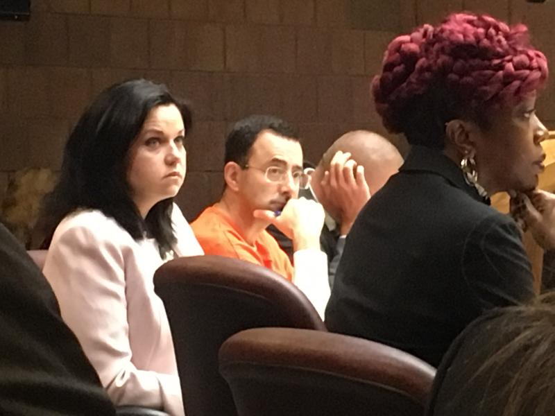 Larry Nassar (in orange) during court hearing.