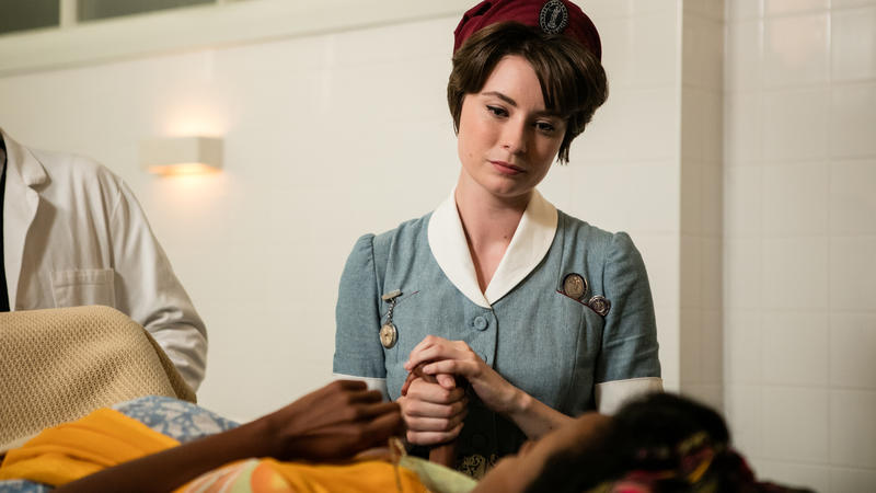 Call the Midwife: nurse holding patient's hand in bed