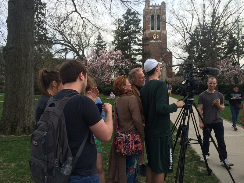 Tim Busfield, Melissa Gilbert, and students filming a scene in front of Beaumont Tower