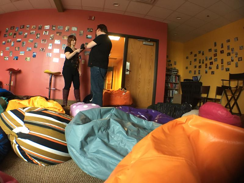 Biggby Coffee President & CEO Bob Fish (right) is in a conference room filled with bean bag chairs.