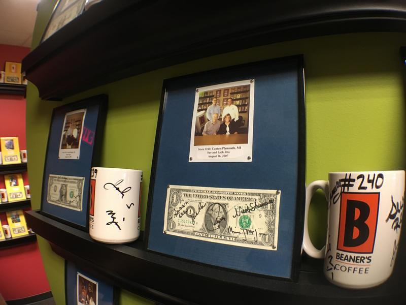 Each new store owner sends a cup, the first customer dollar and picture for framing at Biggby Coffee headquarters.