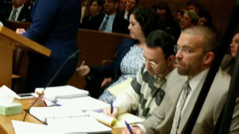Dr. Larry Nassar (sitting center, second from right) during preliminary hearing on May 12, 2017.