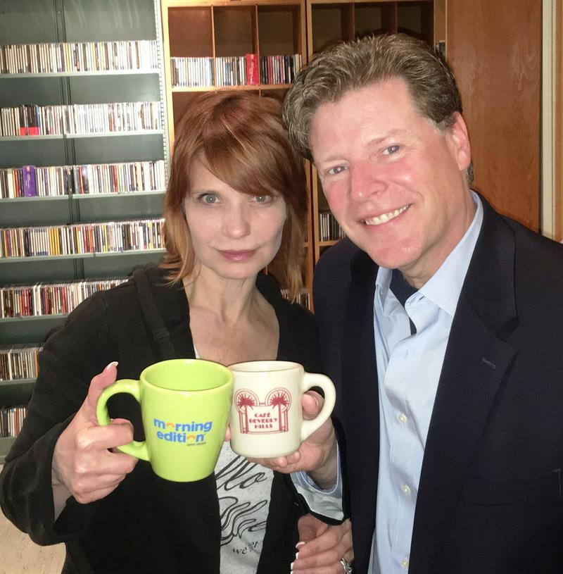 WKAR's Brooke Allen and Executive Producer/MSU faculty member Jim Peck pose with their coffee mugs in the WKAR studios