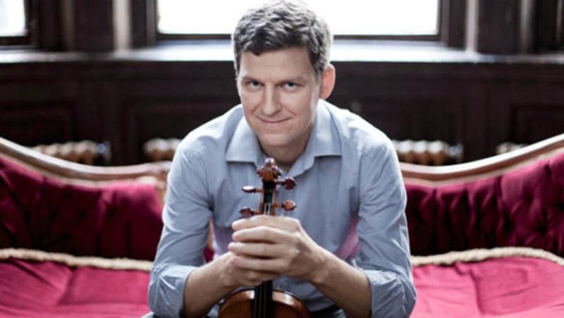 with violin on sofa