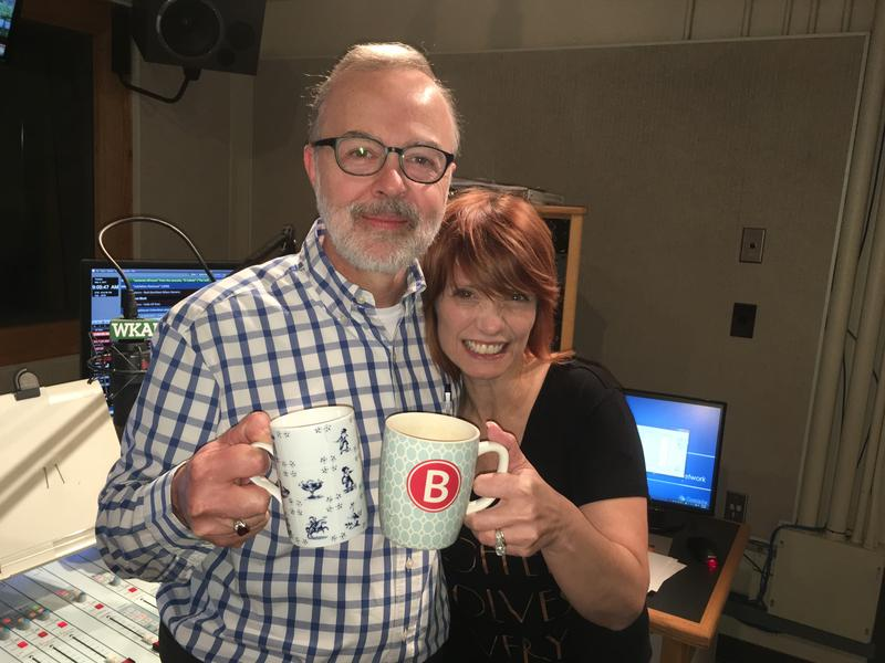 WKAR's Jody Knol and Brooke Allen pose with their coffee cups in the WKAR studios