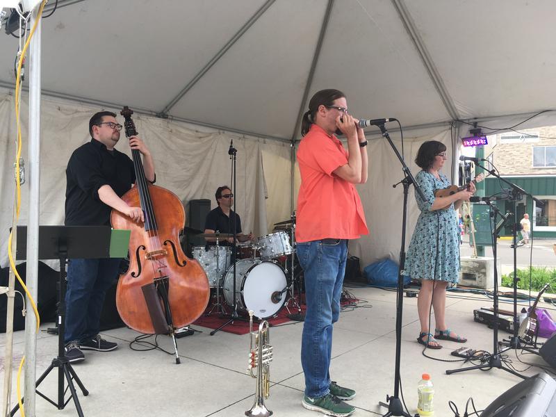 "Lansing band""The Springtails"" perform at East Lansing Arts Festival."