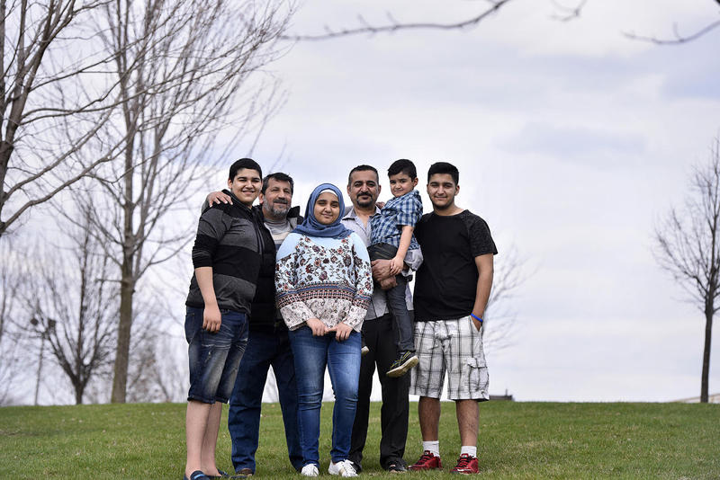 Mohammed Kathem, center behind, with son Arshad, 16, family friend Emad Mohammed, daughter Rokaia, 12, son Yasser, 5, and son Hussain, 18, left to right, at a picnic at Hawk Island in Lansing recently.  Faaza Dawd, (not pictured) her husband Mohammed Kath