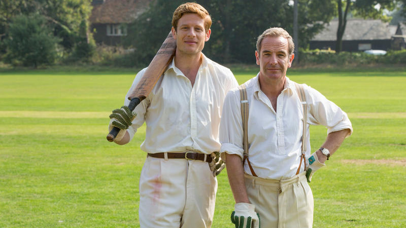 James Norton and Robson Green in cricket outfit on the field