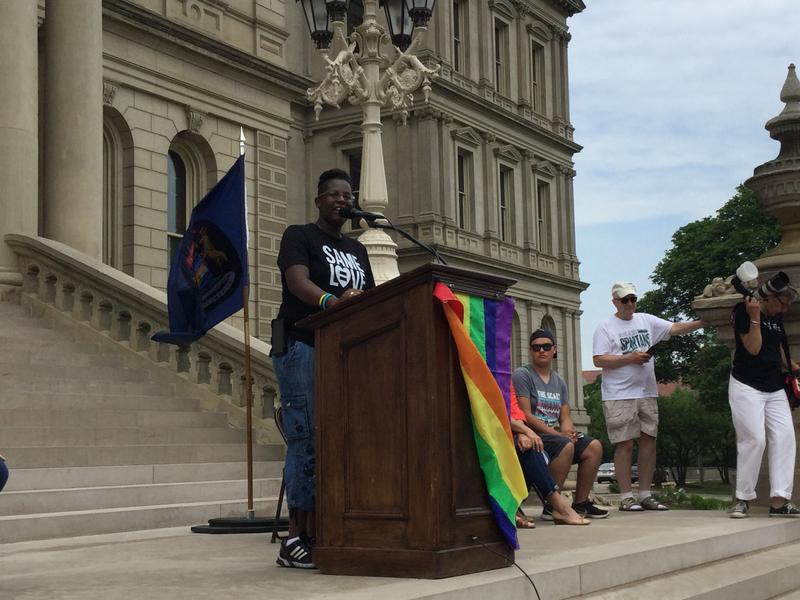 Speaker addresses crowd at Pride rally.